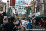 Visitor and People Walking Around Petaling Street